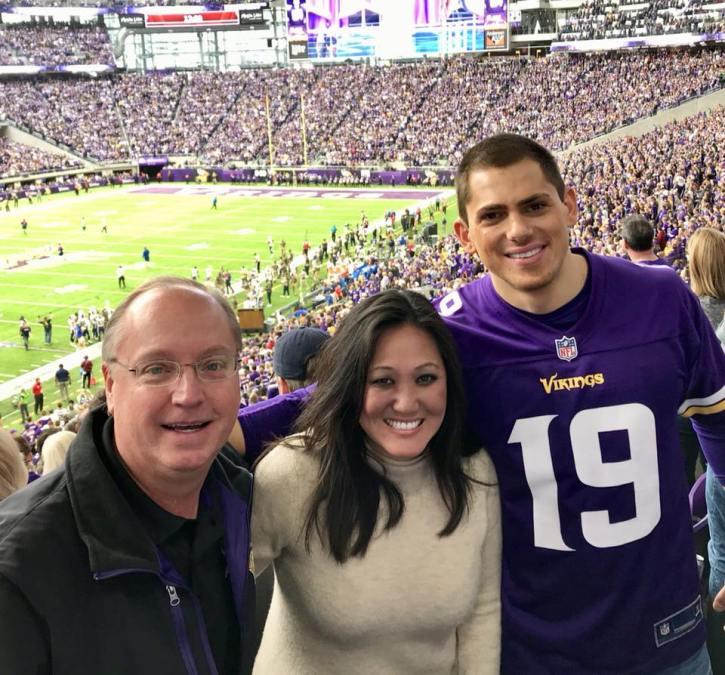 Rep. Jim Hagedorn, Jennifer Carnahan and Anton Lazzaro at a Vikings game.
