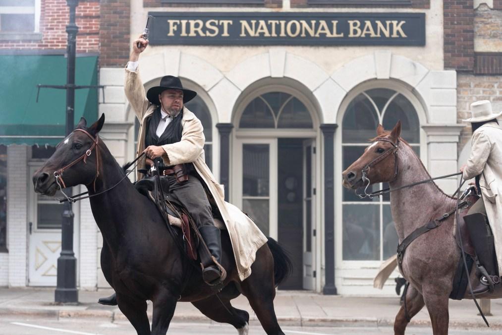 A man on horseback raises his fist outside Northfield's First National Bank
